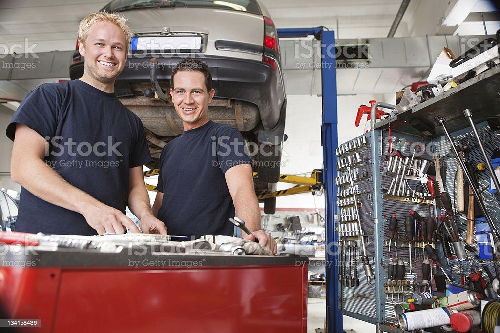 Mechanics at an auto shop royalty-free stock photo
