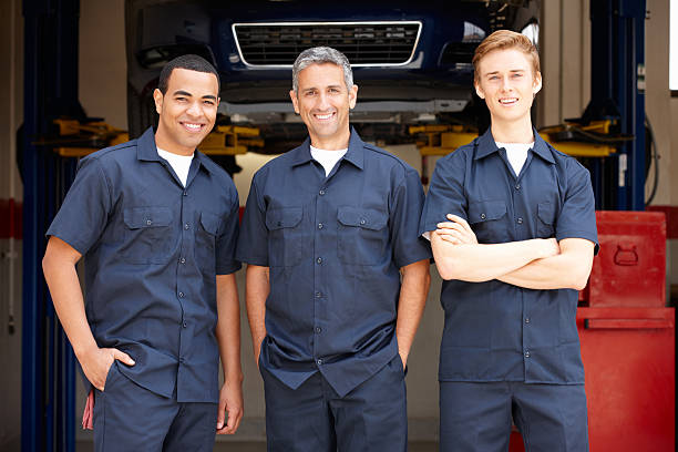 mechanics at work - uniform stock photos and pictures