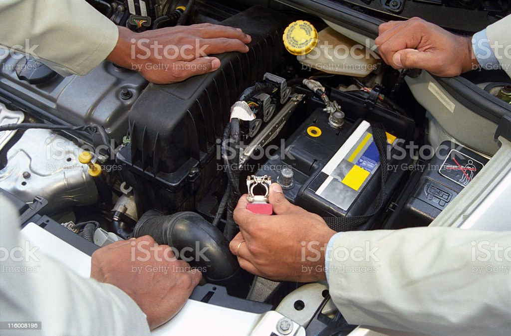 Mechanics checking the car engine stock photo
