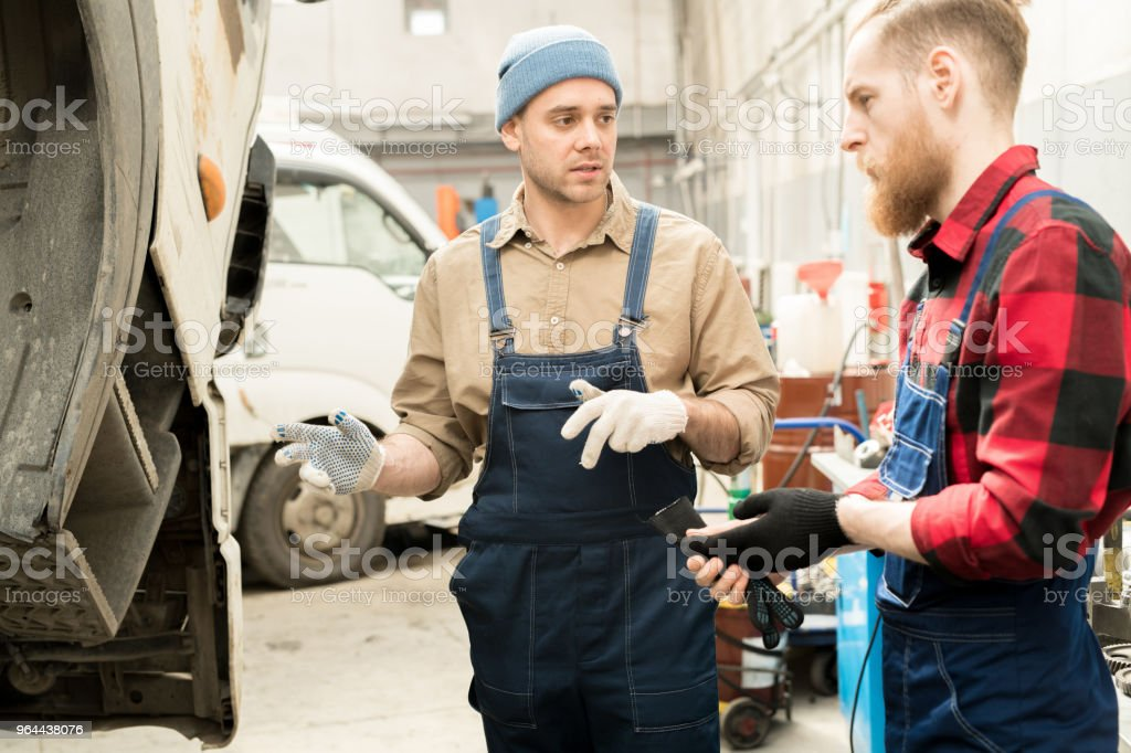 Mechanics Discussing Truck Breakdown - Royalty-free Adult Stock Photo