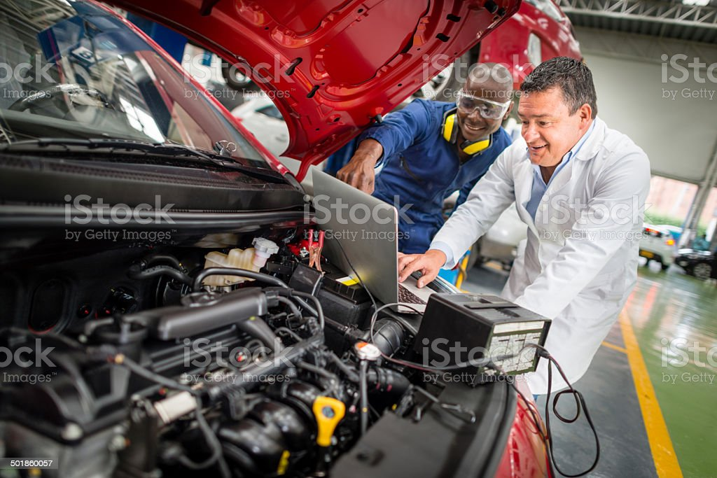 Mechanics fixing a car stock photo