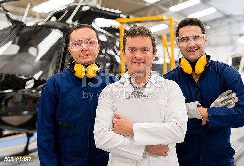 istock Mechanics fixing a helicopter 508121397