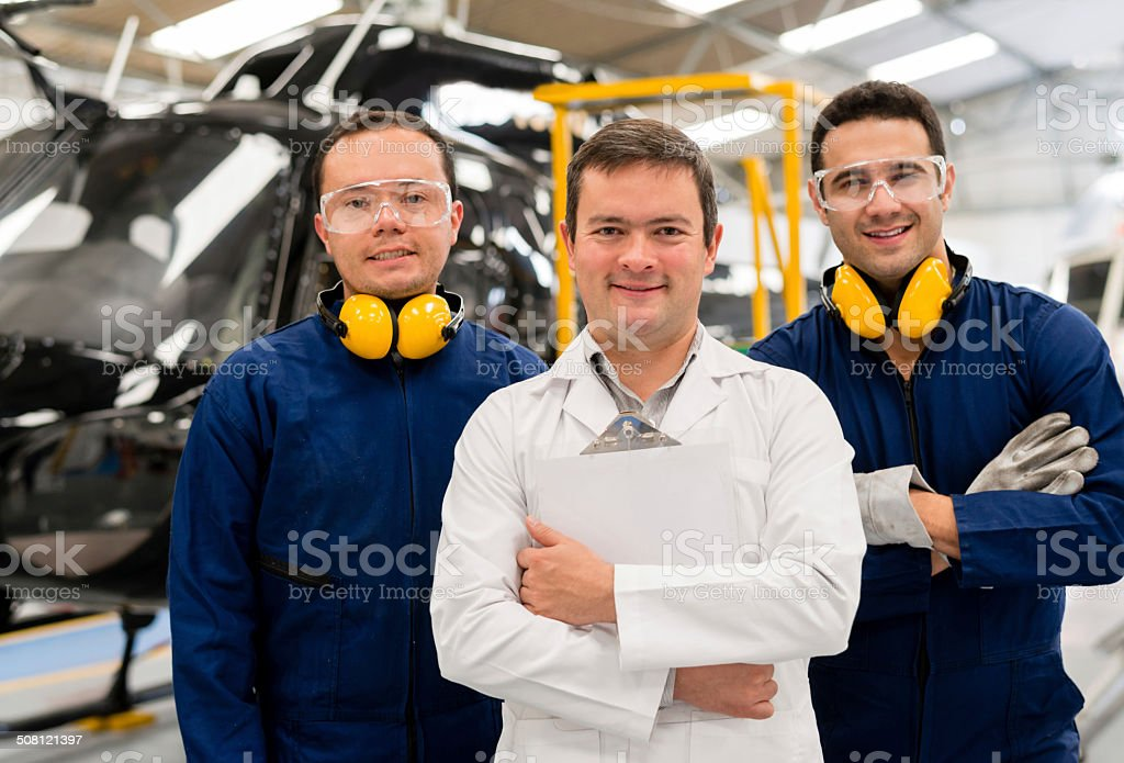 Mechanics fixing a helicopter stock photo