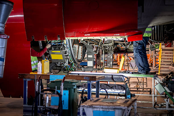 Mechanics fixing jet engine stock photo