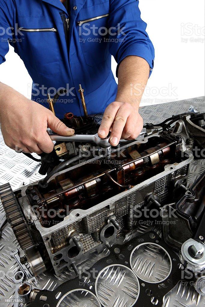 Mechanics hands Mechanic repairing car engine.  the head gasket is visible in foreground. (shot using Canon Eos 1ds mark III) Adjustable Wrench Stock Photo