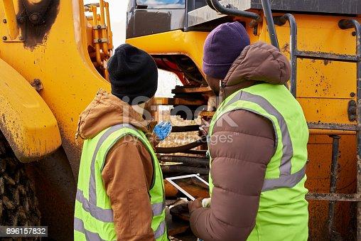 istock Mechanics Inspecting Truck Outdoors 896157832