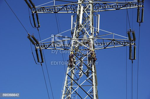 Brunssum, the Netherlands - August 23, 2016: Mechanics maintaine an Electricity Pylon on warm sunny day. End of the week the work must be ready.