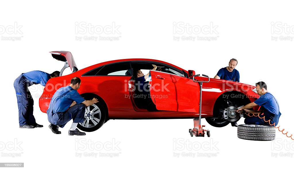 Mechanics working on a car stock photo
