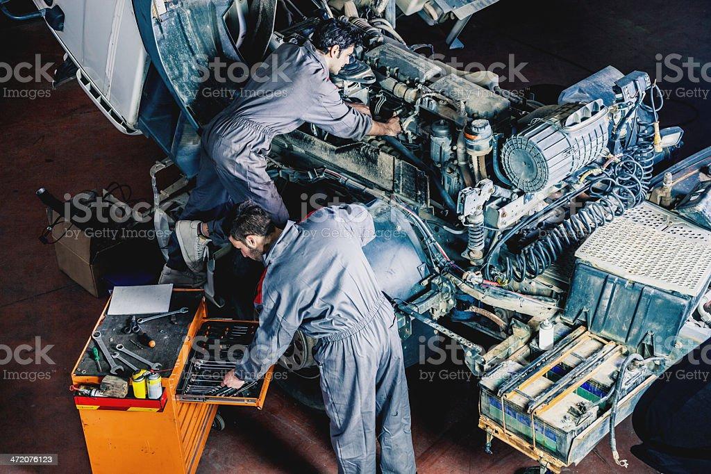 Mechanics working on a truck stock photo