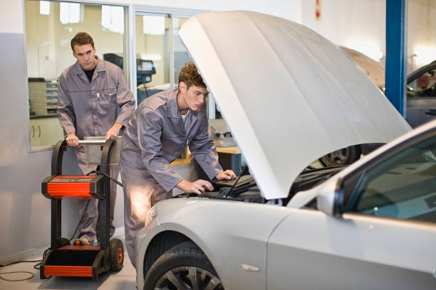Mechanics working on car engine  vehicle hood stock pictures, royalty-free photos & images