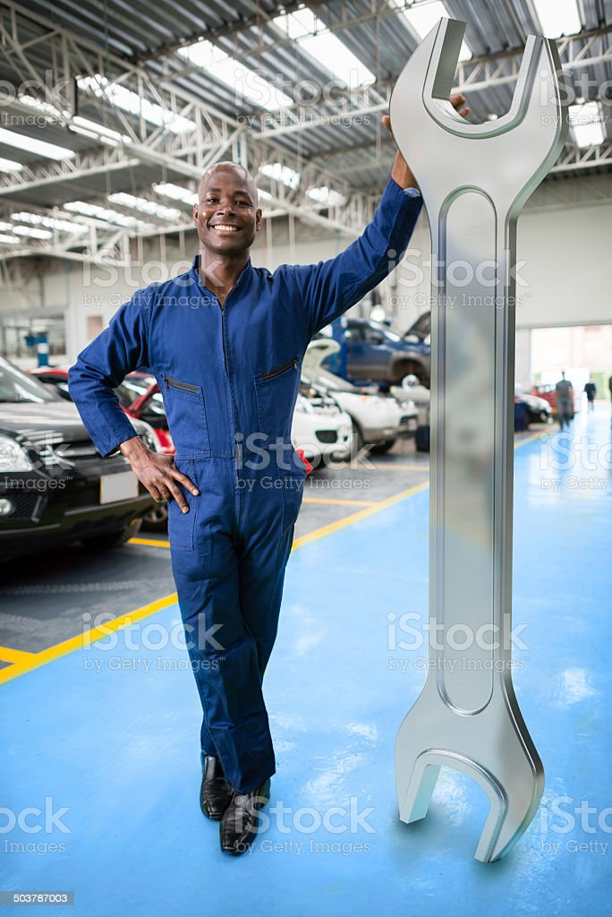 Mechaninc with a 3D wrench stock photo