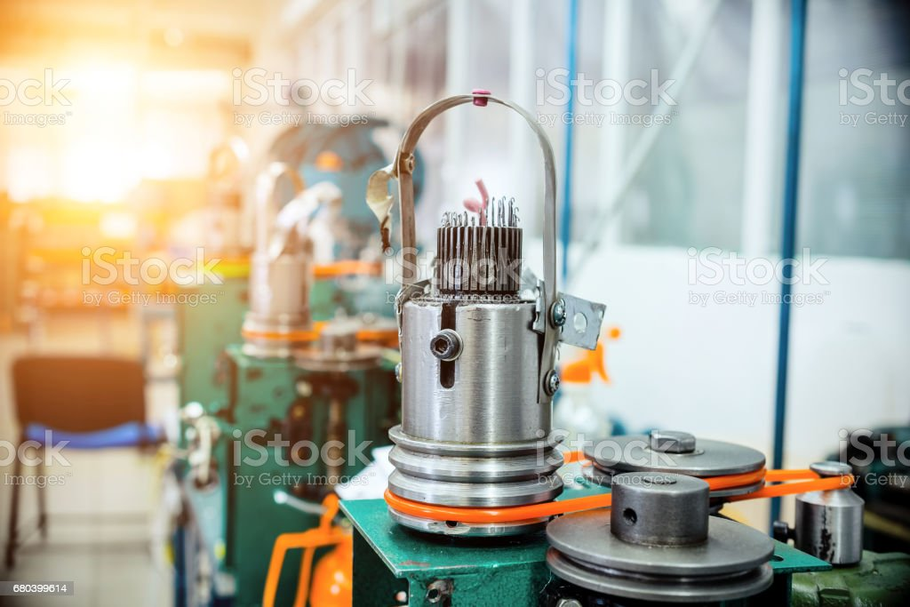 Mechanism for making metal braiding stock photo