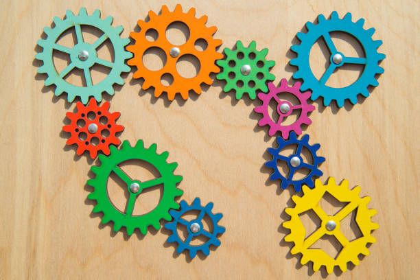 mechanism of multi-colored gears, assembled puzzle. Business concept idea, teamwork, cooperation. collective creative, innovation. copy space. stock photo