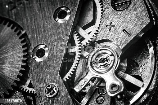 vintage old mechanism with gears and springs, clock mechanism close-up macro, black and white photo