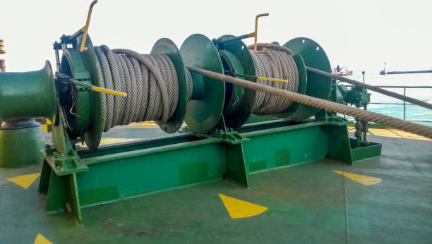 mechanisms of tension control ropes. winches. equipment on the deck of a cargo ship or port - cable winch stock photos and pictures