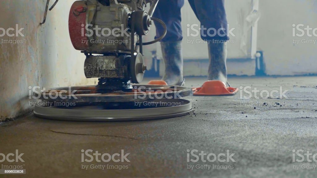 Mechanized grout screed concrete floor close-up stock photo
