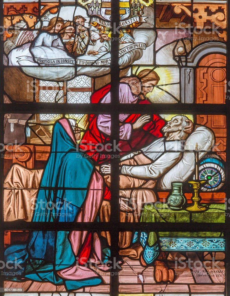Mechelen - Death of st. Joseph on windowpane in Katharinakerk. stock photo