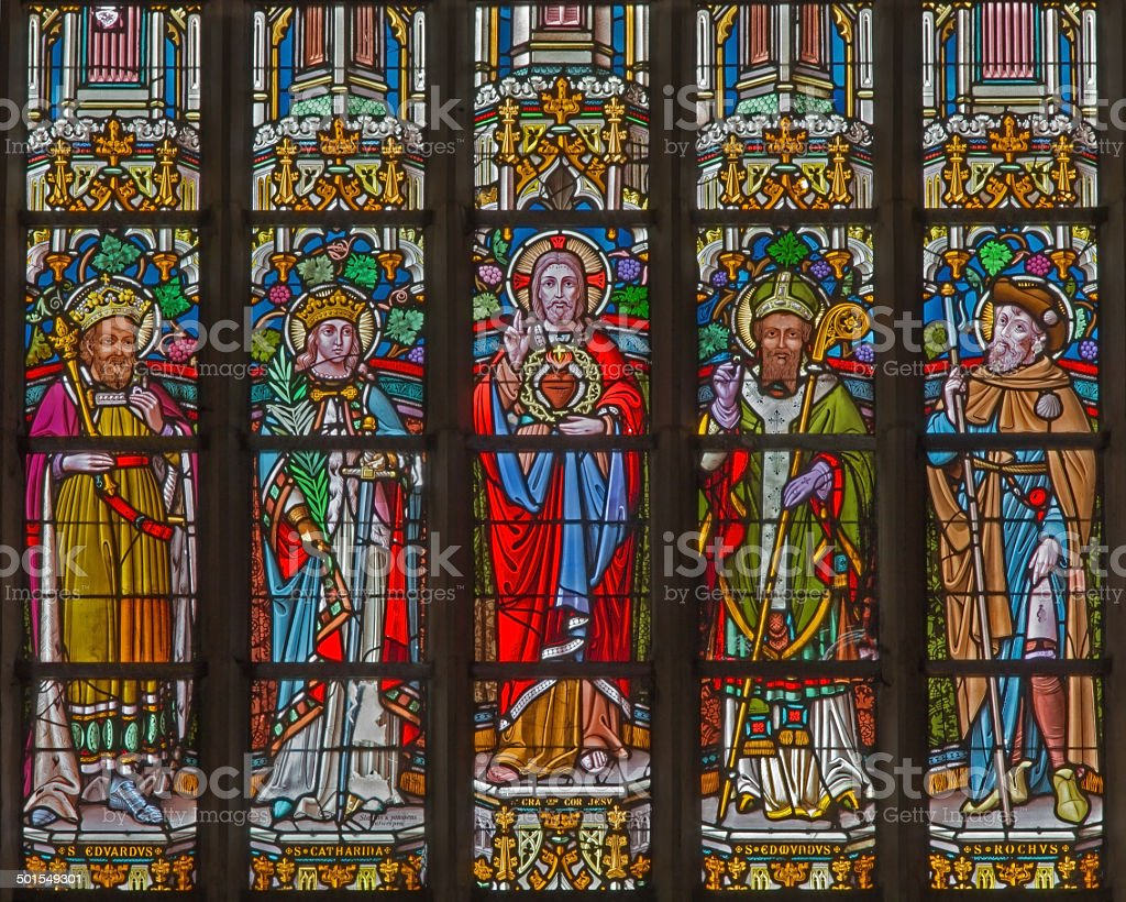 Mechelen - heart of Jesus and saints on windowpane stock photo