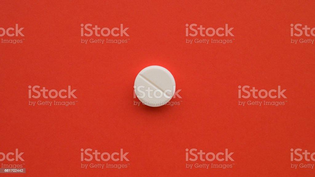 Med pills drugs lsd extasy acid red background stock photo