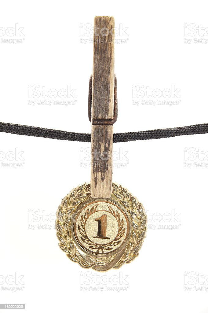 medal, clothespin and rope on a white background royalty-free stock photo