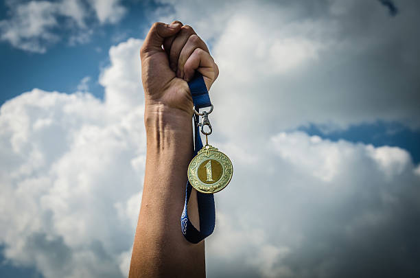 Medal in hand - Photo