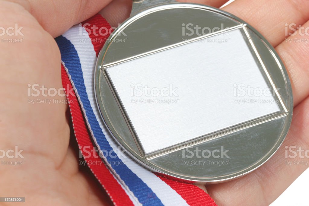 Medal in the hand royalty-free stock photo