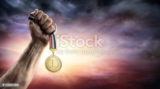 istock Medal Of First Place In Hand - Victory Concept - Medal 3d Rendering 810985088