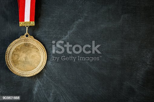 istock Medal on blackboard 903801668