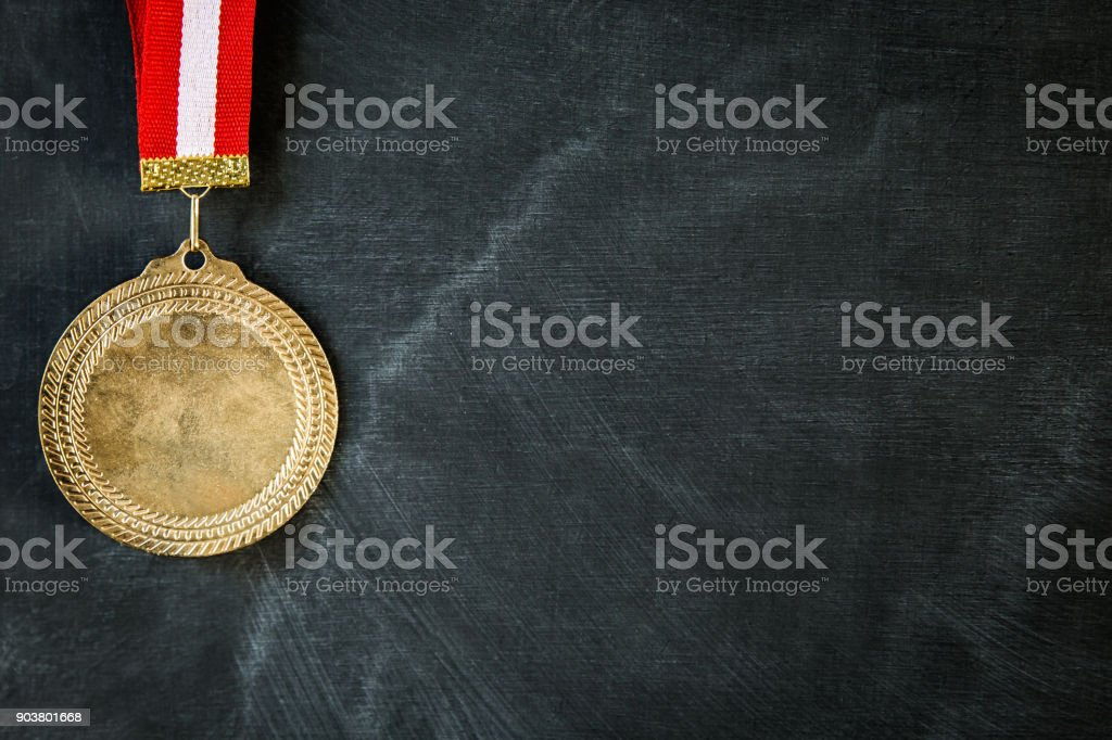 Medal on blackboard stock photo