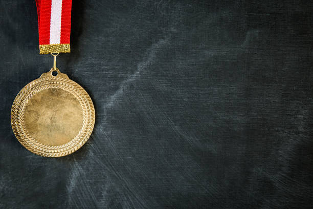 medal on blackboard - medal stock photos and pictures