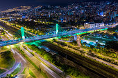 An aerial night view of the emblematic bridge on Medellin City called 4 Sur or (4th South) that connect Western and Eastern sides of the city over the Medellin River.