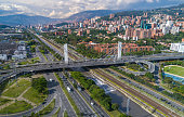 An aerial view of the emblematic bridge on Medellin City called 4 Sur or (4th South) that connect Western and Eastern sides of the city over the Medellin River.