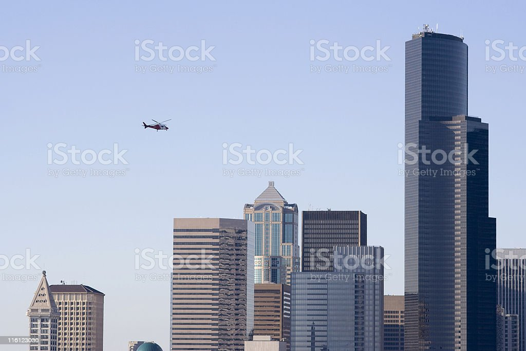 Medevac Helicopter over Seattle skyline stock photo