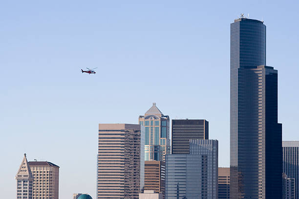Medevac Helicopter over Seattle skyline stock photo