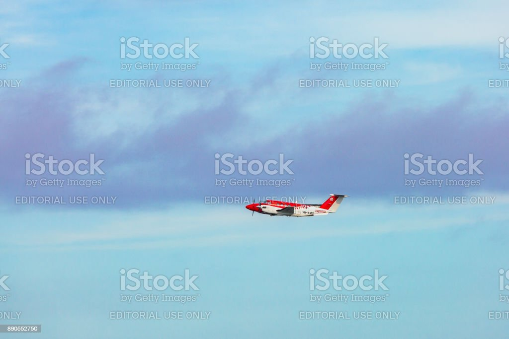 Medevac NSW Air Ambulance (Royal Flying Doctor Service) airborne in cloudy skies stock photo