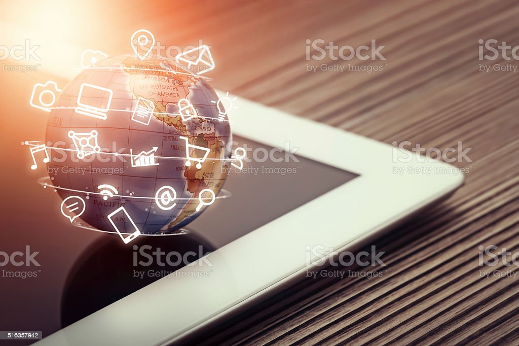 media app icons flying around globe on tablet computer royalty-free stock photo