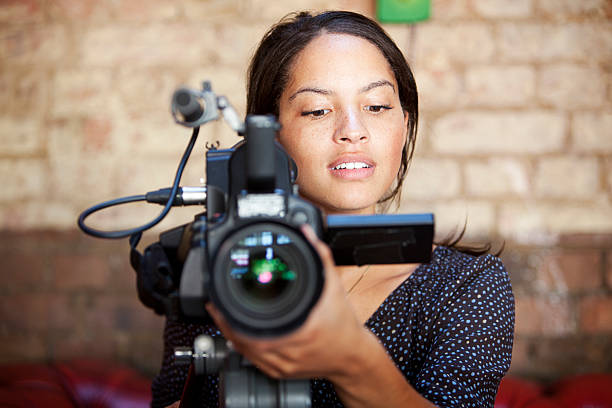 media: camera operator - director stock photos and pictures