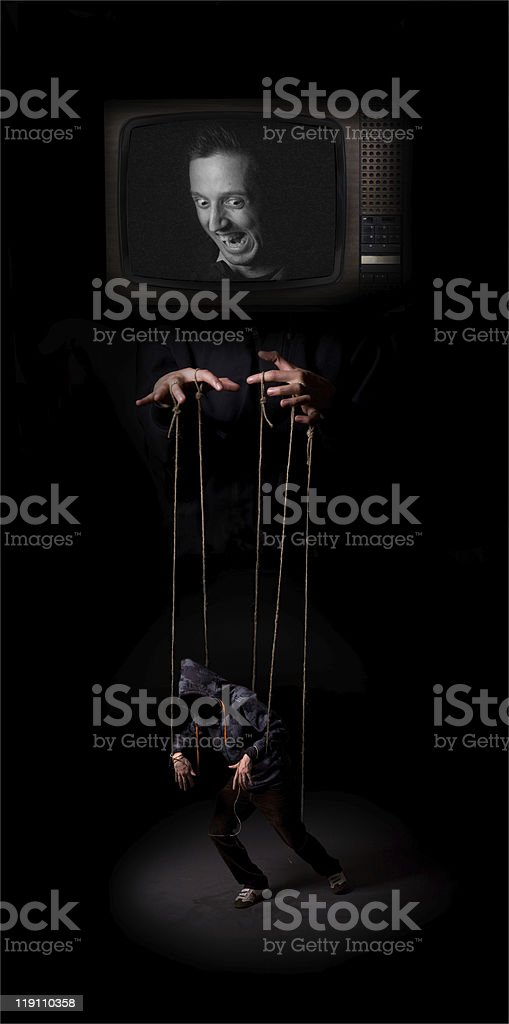 Media controls the marionette puppet royalty-free stock photo