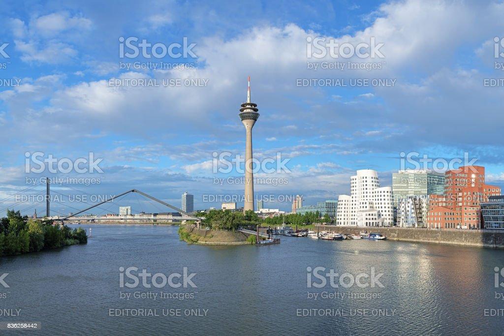 Media Harbor in Dusseldorf with Rheinturm TV tower and Buildings of Neuer Zollhof, Germany stock photo