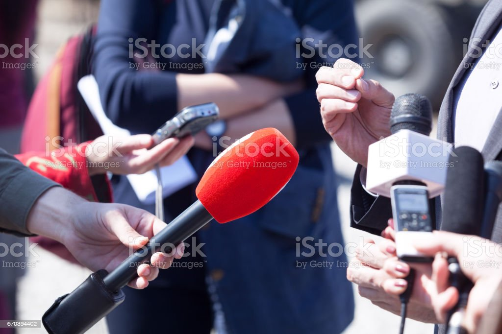 Media interview. Broadcast journalism. News conference. Microphones. stock photo
