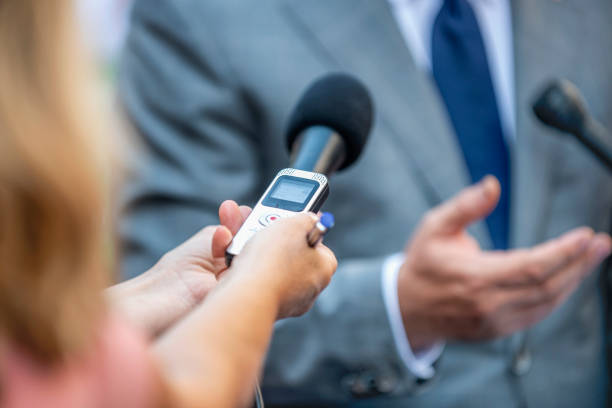 media interview. journalists interviewing politician or businessman - dictaphone stock pictures, royalty-free photos & images