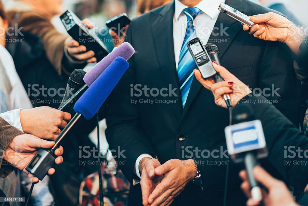 Media interview Politician or business person having interview with politicians. Toned image Adult Stock Photo