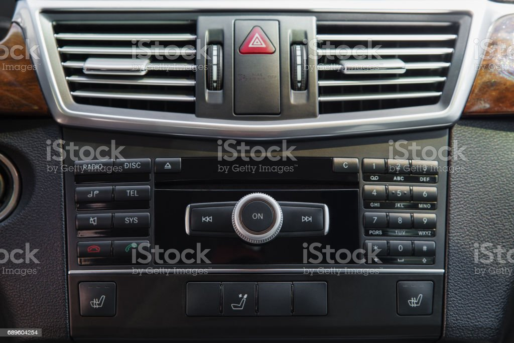 media system on the control panel of the car, the management console, emergency stop button, car interior stock photo
