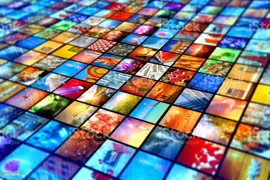 Media wall with screen broadcasting multiple video images stock photo