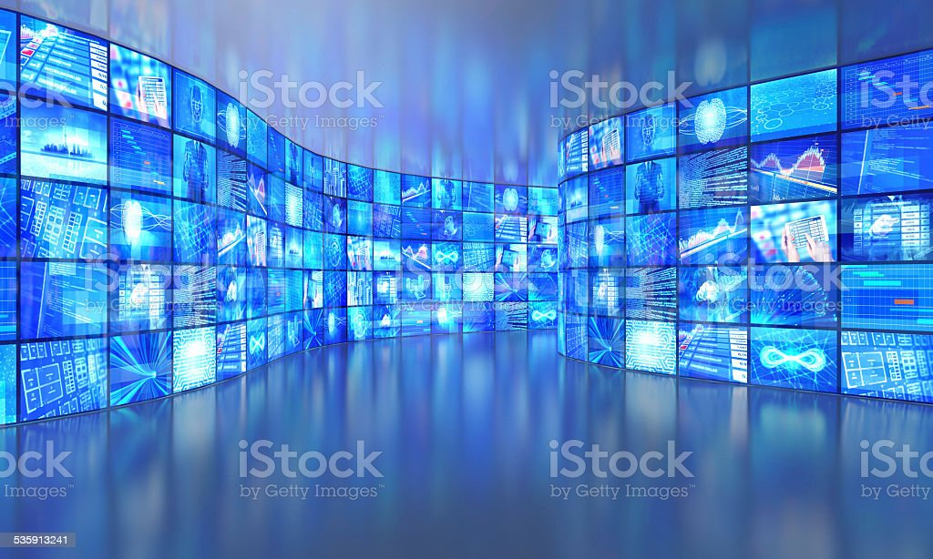 Media walls with video images in a large gallery stock photo