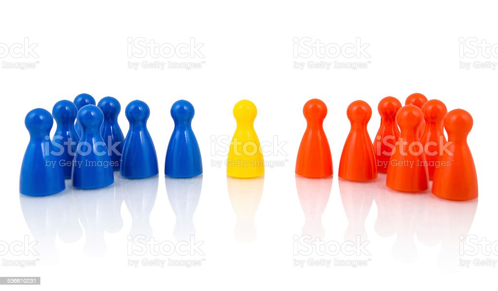Mediation and unification concept Yellow pawn in the middle between red and blue pawns 2015 Stock Photo