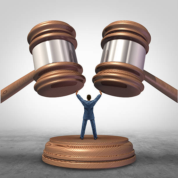 Mediation Resolution Mediation resolution and mediate legal disputes in business as a concept with a businessman or lawyer separating two judge mallets or gavel as competitors in arbitration. detach stock pictures, royalty-free photos & images