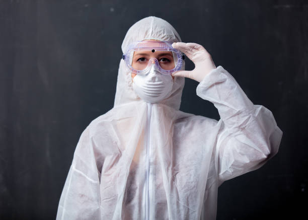 medic woman wearing protective clothing against the virus stock photo