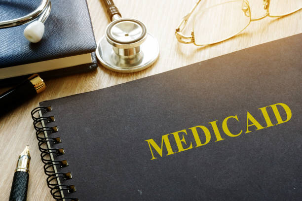 Medicaid concept. Documents, pen and stethoscope. stock photo