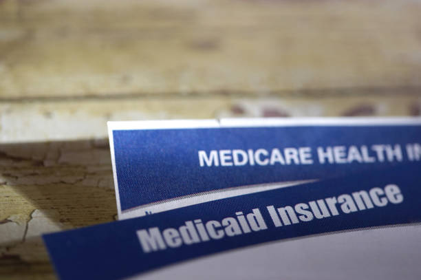 medicaid close up shot of medicaid card medicare stock pictures, royalty-free photos & images